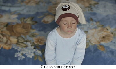 A boy fell asleep while sitting on the couch - Little boy is...