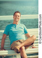 Handsome man tourist on pier. Fashion summer. - Handsome man...