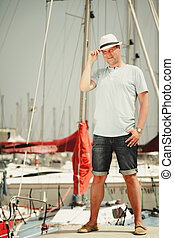 Handsome fashion man on pier in port with yachts - Handsome...
