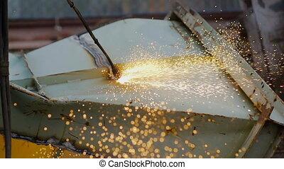 Gas Welder Makes a Cut Metal Spark - Gas Welder Makes a Slit...
