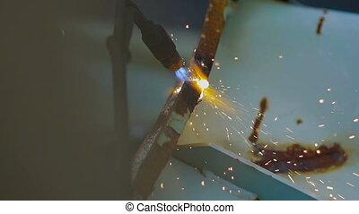 A Fiery Stream of Gas Wlder Cut a Metal Scrap - A Fiery...