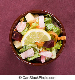 Salad closeup - Batavian lettuce with carrots, beetroots,...
