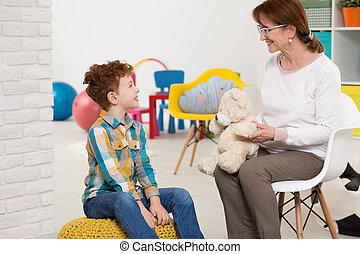 Therapist working with autistic kid - Elderly nice...