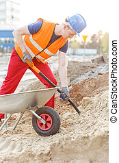 Builder with shovel and barrow - Picture of handsome builder...