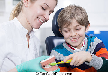 Getting familiar with a dentist's office - Young hygienist...