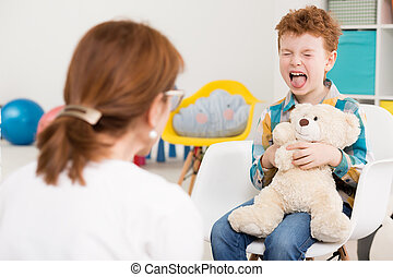 Naughty child at psychologist's - Naughty young boy with...