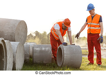 Hard working road builder - Image of hard working road...