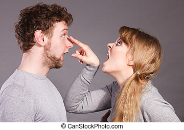 Aggressive woman yelling on man. - Violence against man....