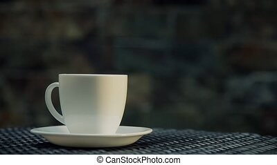 Serving coffe on white cup