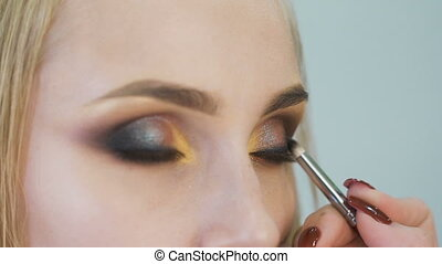 portrait of an attractive, fresh blondes. It is the top model, she made a spectacular makeup for a photo shoot, or the podium.