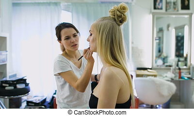 Finishing touch. In the salon for beautiful blondes do...