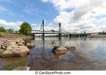 Hawthorne Bridge over Willamette River on the waterfront in...
