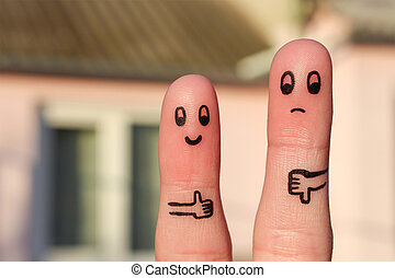Finger art of couple. Woman showing thumbs up and man...