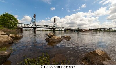 Time lapse of clouds over Willamette River with Hawthorne Bridge in Portland Or
