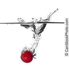tomato splash in water - closeup image of tomato splash in...