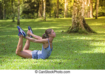 Young woman stretching before Fitness