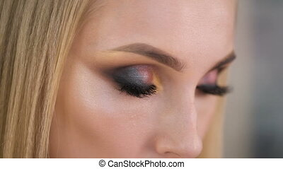 Burn look. Expressive makeup on the eyes, very pretty girl...