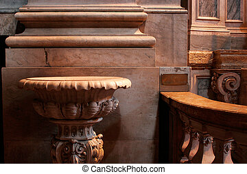 Baptismal font in stone marble;