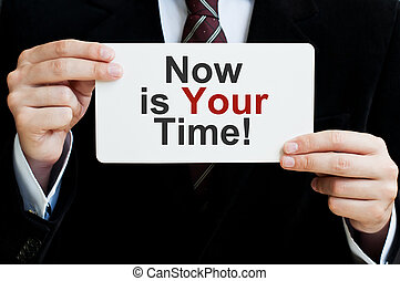 Now is Your Time Businessman holding a card with a message...