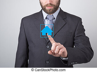 technology, internet and networking concept - Businessman presses home button on virtual screens. Internet technologies in business