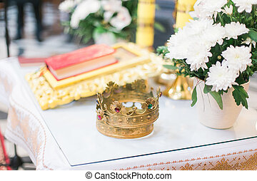 Orthodox wedding ceremonial crown and the Bible, ready for a crowning ceremony
