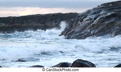 Large waves beating against the rocks in the North Sea....