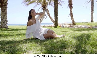 Gorgeous lady sitting among palm trees - Relaxing gorgeous...