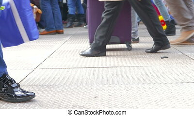 Commuting During Rush Hour - Scene with peoples legs walking...