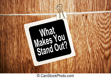 What Makes You Stand Out. Text on blackboard