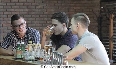 Guys talk at the bar - Three guys having a nice talking at...