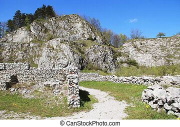old walls in abandoned quarry - rocks in former limestone...