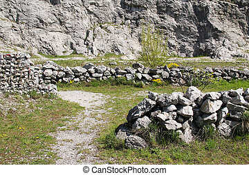 old walls in abandoned quarry - old stone walls under the...