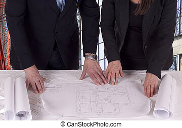 Going over the blue print - Developer and architect looking...