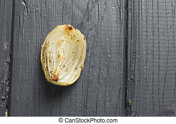 Baked onion above view - Baked onion on a wooden tabletop...
