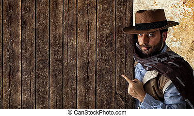 Gunfighter pointing on wooden table - Gunfighter of the wild...