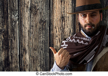 Gunfighter pointing on wooden table. - Gunfighter of the...