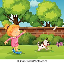 Girl playing with pet dog in the yard