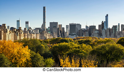 Fall in Central Park with Midtown Skyscapers New York City -...