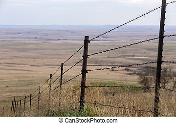 barbed wire fence, Flint Hills - barbed wire fence on steep...