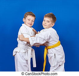 Two athletes train judo techniques