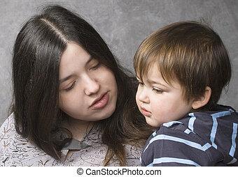 Mother consoling her child - Mother consoling her son,...