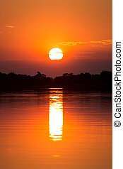 African sunset over the Okavango delta Okavango delta of...