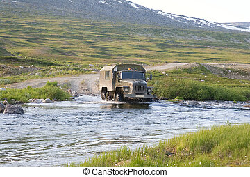 Truck crossing a river - Russian truck Ural crossing a small...