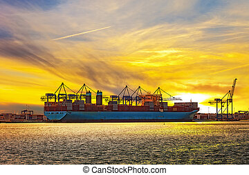 Container ship at sunset