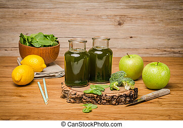 Green fresh leafy greens smoothie in glass jar, spinach...