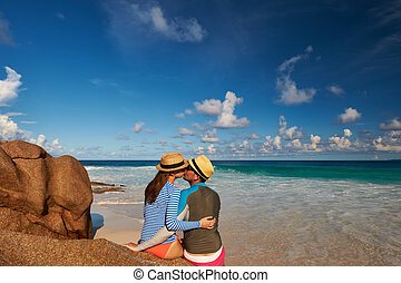 Couple at tropical beach wearing rash guard - Couple on a...
