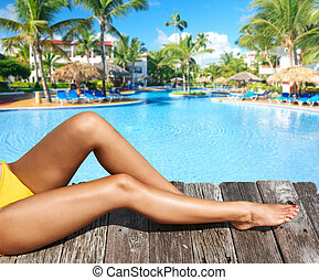 Woman at poolside - Woman relaxing at the pool