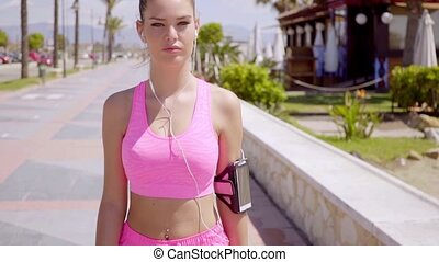Gorgeous blond wearing pink shorts and top while listening...
