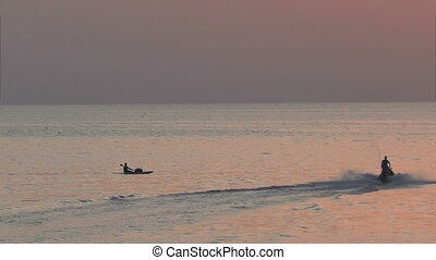 Jet ski and kayak on sea - Kayak and jet ski in the ocean in...