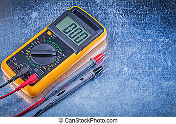 Digital electrical tester on metallic surface directly above...